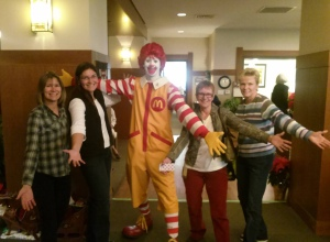 Associates show off their love for volunteering with Ronald McDonald himself.